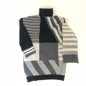 Oversized turtle neck geometric sweater